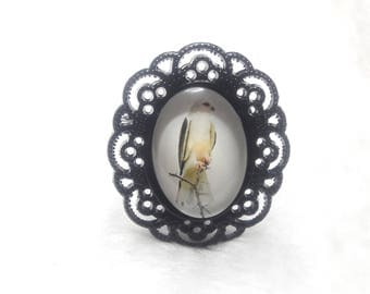 The White Bird black oval brooch