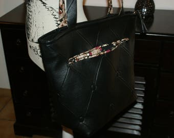 large black faux leather tote bag