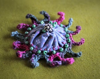 Unique grey pink green beaded vintage Suffolk Puff crocheted brooch