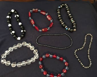 Beaded Bracelets- lot of 7- need restringing- fun to use for dress up or repurposing beads.