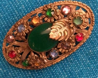 1910 Slovaquie Art Nouveau Brass Oval Brooch with Floral Design Claw Set Crystals and Mounted Green Cabochon