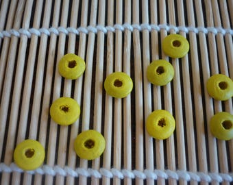 Yellow disk 10 mm wooden beads, sold in packs of 10.