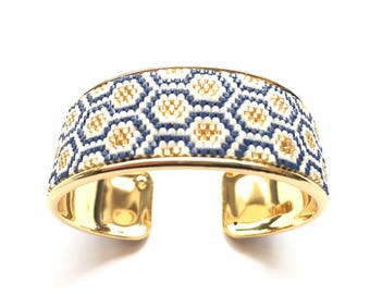 Very nice cuff, Navy, white and gold woven on rigid black Miyuki