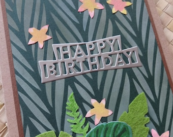 Tropical happy birthday card with plumeria flowers and foliage