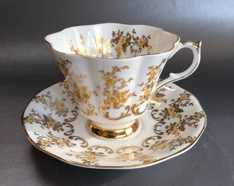 Queen Anne Gold and Yellow Flowers Bone China Tea Cup and Saucer England