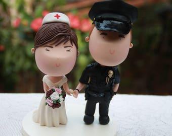 Couple holding hands. Police Officer and Nurse. Handmade. Fully customizable. Unique keepsake. Custom cake topper.