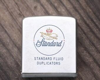 Vintage Zippo advertising tape measure from Standard Fluid Duplicators