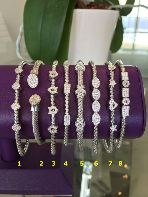 Sterling silver bracelets set enticingly with pave cubic zirconia, Absolutely stunning