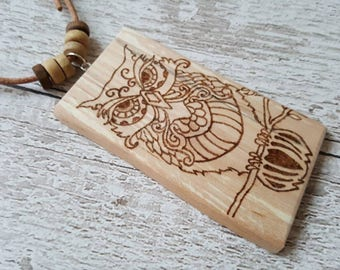 Natural unique bohemian wooden pendant with pyrography art