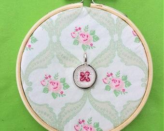 Handmade cross stitch necklace a red stitch