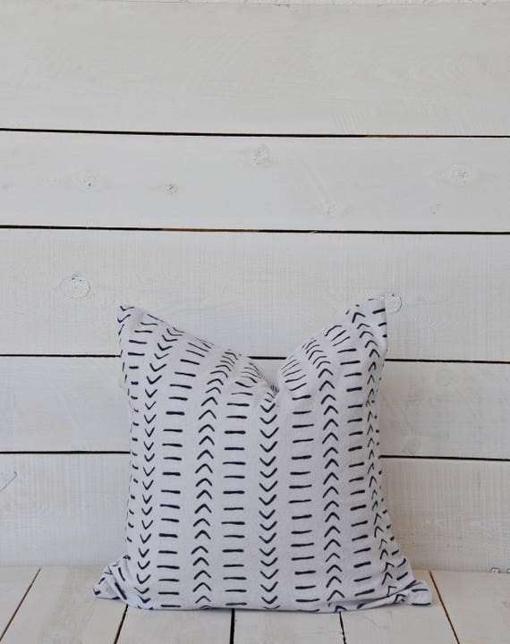Mud Cloth style pillow cover, dashes and arrows, black, shown in 20x20 and available in 16x16, 18x18, 20x20, 16x24 and 16x26.
