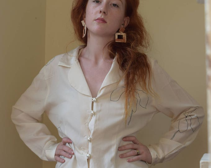 lydia blouse with satin details.