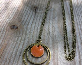 Necklace bronze double rings and orange enamel pendant