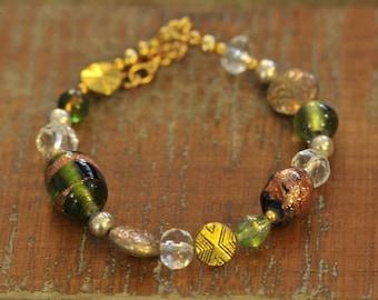 Glass & Crystal Bracelet, Vintage Glass, Adjusts up to 8.25 inchs, Adjustable bracelet with gold, silver, green, copper accents