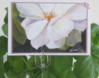 Small blank card of acrylic white flower