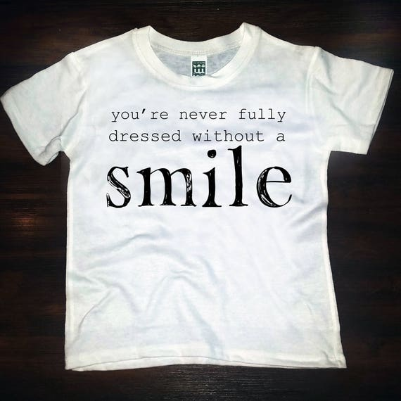 You're Never Fulled Dressed Without A Smile- tee