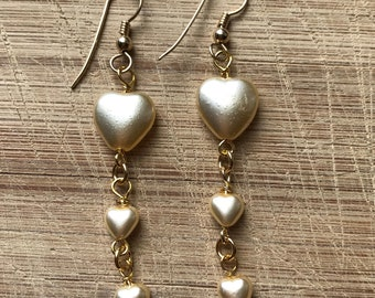 Pearl covered glass heart earrings on gold French wires