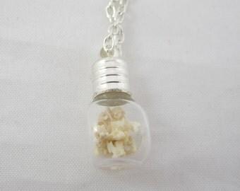 Tiny Vial of Vertebrae Pendant Necklace