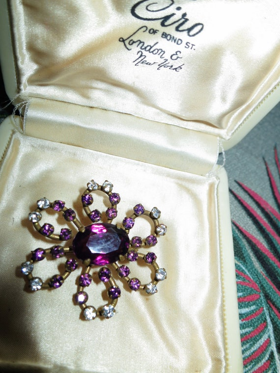 Lovely antique Deco  amethyst glass  gold metal brooch