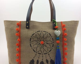 """Tote bag in Burlap accented with orange tassel, Bohemian chic and ethnic style. """"Dream"""" painted on the front of the bag"""