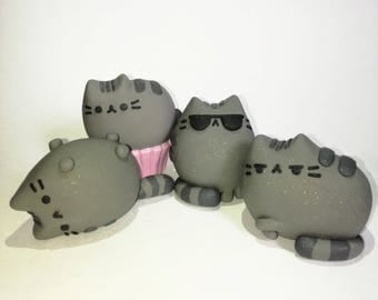 Pink cupcake pusheen the cat figure facebook messenger charm desk summer glasses lying