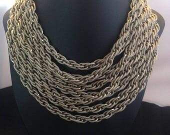 Elegant multi strand gold coloured multi strand bib necklace