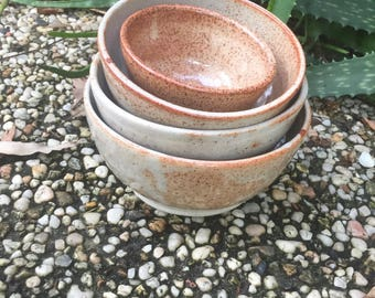 Five Wheel thrown bowls, same earthy colour tones.  Made with love and joy.