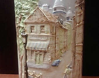Oval vase painted with a scene of an old town from mid 1900s made unknown