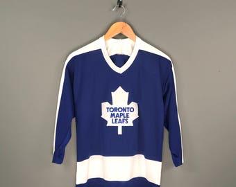 80s Toronto Maple Leafs CCM NHL Hockey Jersey. Vintage 80s Toronto Maple Leafs Blue Away CCM Hockey Jersey.