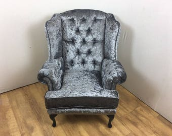 Wing Back Chair with deep buttoned arms - black queen anne legs