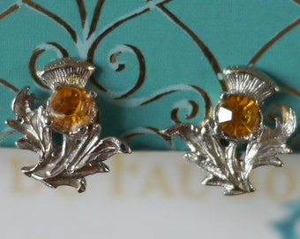 Clip on Scottish thistle earrings, silver tone metal with orange stones