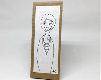 Simple black and white drawing on paper and cardboard, decorative, gift, illustration - woman with the striped sweater