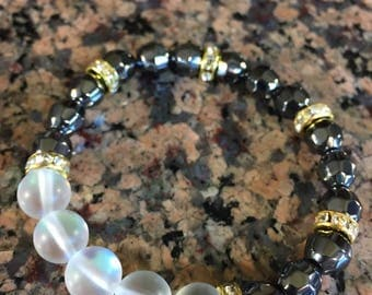 Stretchy genuine natural moonstone and hematite bracelet, with gold finished rhinestone spacers.