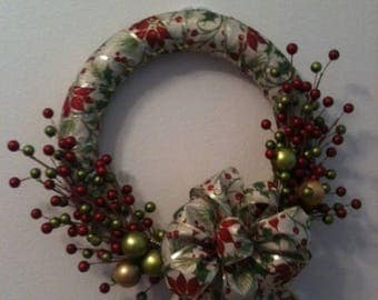 christmas gold wreath with red berries