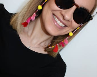 Necklace / Bracelet for sunglasses from beads, PomPoms and tassels in pink red yellow pink gold