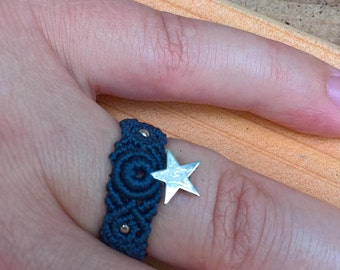 Dark blue ring with silver star