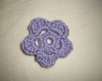 Set of four purple crochet flowers