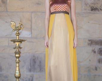 Indian-inspired yellow paneled sleeveless dress