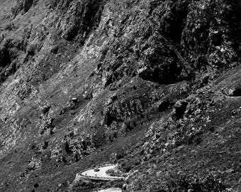 Epic Photo of a car traversing down a mountain path on a summers day wall art | fine art photography