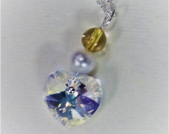 Sterling silver necklace with a Swarovski crystal heart - crystal clear with a hint of gold