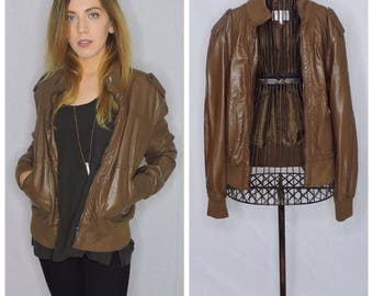 retro styled dark brown leather jacket with cloth accents