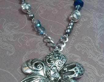 Necklace with big metal flower, hexagon glass beads in royal blue color