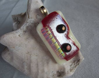 Large cream and dark red glass pendant with inclusion iridescent worked metal leaf and glass beads