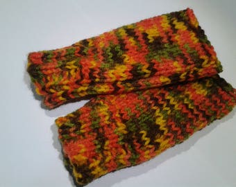 Multicolored mittens in shades of orange Green Brown and yellow.