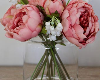 Peonies and Lillies of the Valley, in a small vase permanently set in artificial water