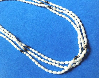 Vintage! 14k gold freshwater white pearls & onyx triple strand necklace.