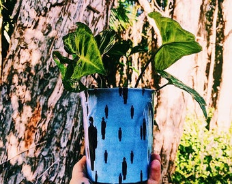 Rene Magritte's Golconda Indoor Paper Pot Plant