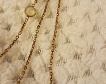 A vintage gold and crystal wrappable necklace
