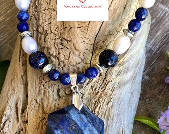 Lapis Lazuli, freshwater Pearls and Goldstone beaded necklace with a Lapis Lazuli pendant.