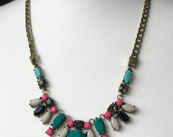 Bib style statement necklace in teal green and pink
